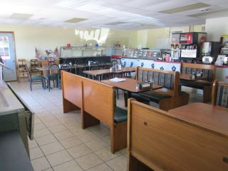 Attached is the ice cream shop with plenty of seating space.