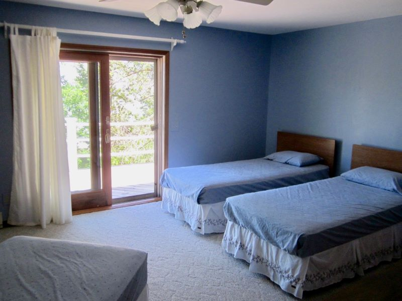 Large master bedroom, currently there are 3 twin beds but there is lots of room for a king bed.