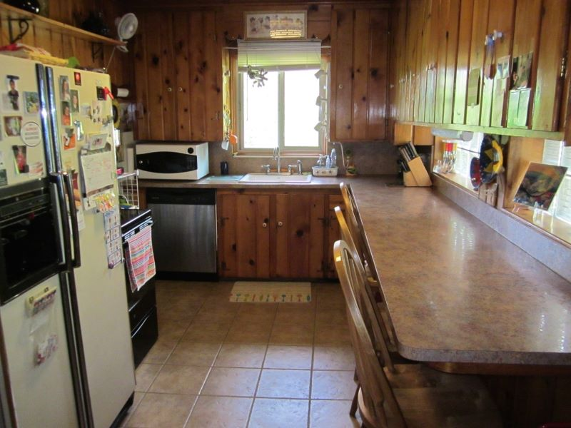 Galley kitchen with snack counter