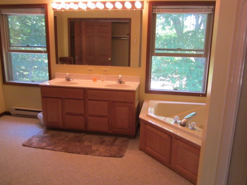 Master bath..garden tub, shower stall, vanity and large storage closets.